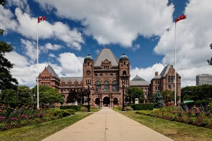 Ontario has committed to a basic income pilot in a new budget. (Pictured: The Ontario Legislative Building)