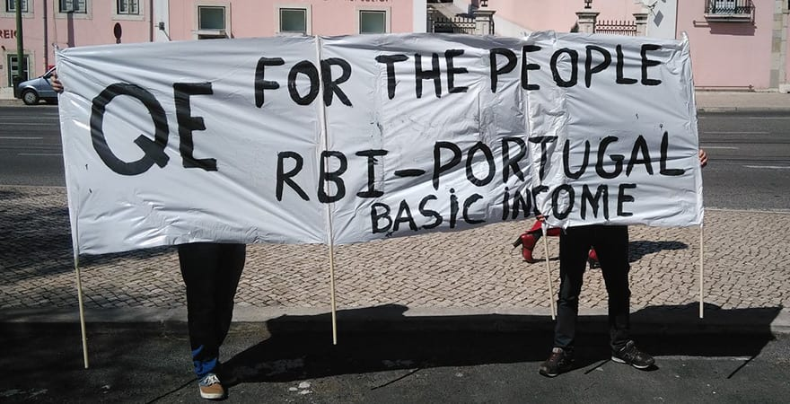 """PORTUGAL: Draghi welcomed by """"Quantitative Easing for the People"""" demand while in Lisbon"""