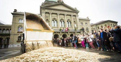 Coins poured outside of the Federal Palace in Bern