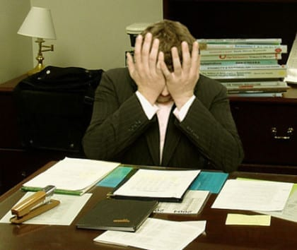 """""""Frustrated man at a desk"""" CC LaurMG"""