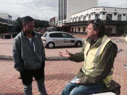 Basic Income discussion with BINZ car in background